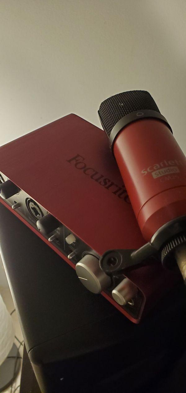 Focusrite Scarlett 2i2 Audio Interface With Scarlett Studio CM25 Microphone.