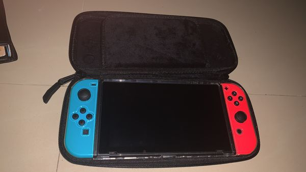 Nintendo Switch with Super Mario Odyssey game